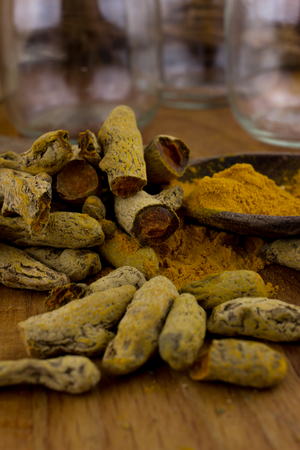 grinded tumeric on spoon Stock Photo