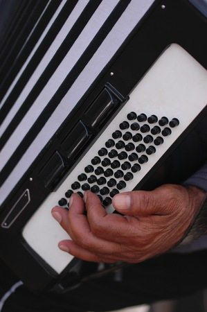 streetlife: The hand of a musician playing the accordions outdoors Stock Photo