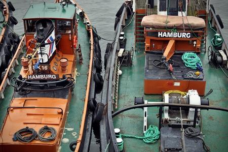 st pauli: May 2015, St. Pauli, Hamburg. Frontal view of fishing boats docked at Hamburgs Sankt Pauli harbour