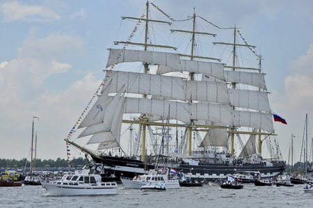 19 years: Ij River, Amsterdam, the Netherlands - August 19, 2015: The Kruzenshtern tall ship Russia on the Ij river, approaching the port of Amsterdam on the 1st day of the SAIL 2015 www.sail.nl, an international public nautical event held once in every 5 years sin Editorial