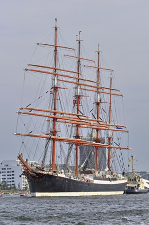 Port Amsterdam, Amsterdam, the Netherlands - August 23, 2015: The Sedov tall ship Russia cruising escorted on the last day of the SAIL 2015 www.sail.nl, an international public nautical event held once in every 5 years since 1975. Editorial