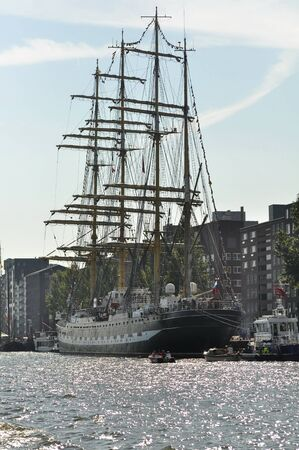 yea: Port Amsterdam, Amsterdam, the Netherlands - August 20, 2015: Back view of the Kruzenshtern tall ship Russia docked in the Ijhaven port of Amsterdam, at the time of the SAIL 2015 www.sail.nl, an international public nautical event held once in every 5 yea Editorial