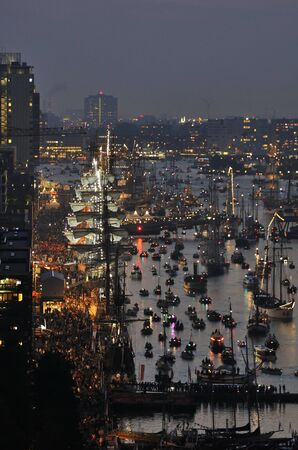 19 years: Port Amsterdam, Amsterdam, the Netherlands - August 19, 2015: Night view of the Ijhaven port at the time of the SAIL 2015 www.sail.nl, an international public nautical event held once in every 5 years since 1975.