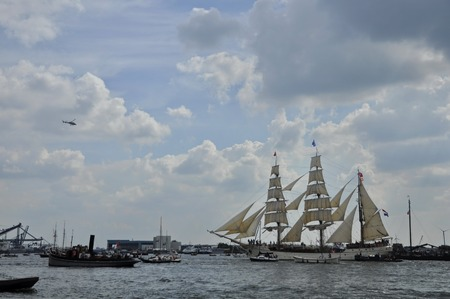 19 years: Ij River, Amsterdam, the Netherlands - August 19, 2015: Distant view of the Europa tall ship Holland on the Ij river, approaching the port of Amsterdam on the first day of the SAIL www.sail.nl, an international nautical event held every 5 years since 1975