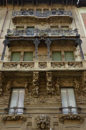 cherubs: Milan, Italy - October 4, 2015: Balconies of an art nouveau residential building on the Via Marcello Malpighi