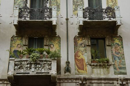 art vintage: Milan, Italy - October 4, 2015: balconies of a residential building on the Via Marcello Malpighi.