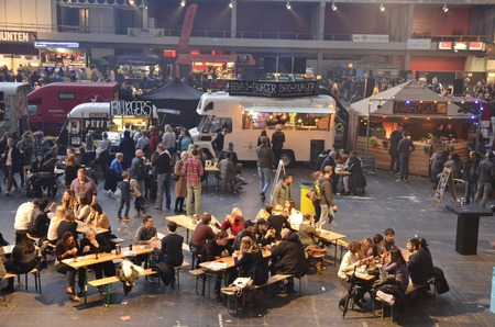blanche: Amsterdam, the Netherlands - November 29, 2015: Visitors at the Petit Amsterdam and the Cart Blanche food trucks in the Europe Complex Europahal at the Foodfestival Amsterdam 2015 at the RAI