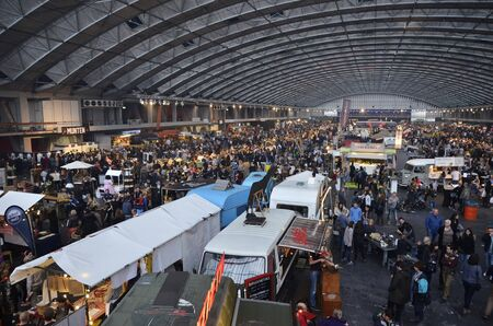 mezzanine: Amsterdam, the Netherlands - November 29, 2015: The busy Europe Complex Europahal viewed from the East mezzanine at the time of the Foodfestival Amsterdam at the RAI