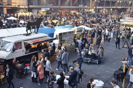 socialising: Amsterdam, the Netherlands - November 29, 2015: Visitors at the Spaanse Worst Lust and the Zilt en Zalig food trucks in the Europe Complex Europahal at the Foodfestival Amsterdam 2015 at the RAI Editorial