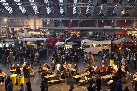 blanche: Amsterdam, the Netherlands - November 29, 2015: The Fruitland, Pachamama, Petit Amsterdam and Cart Blanche trucks in the Europe Complex Europahal at the Foodfestival Amsterdam 2015 at the RAI