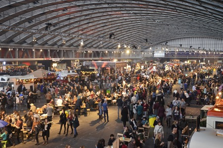 Amsterdam, the Netherlands - November 29, 2015: The central section of the busy Europe Complex Europahal, viewed from the north mezzanine at the time of the Foodfestival Amsterdam at the RAI