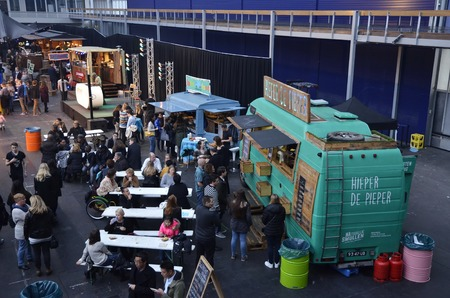 latin food: Amsterdam, the Netherlands - November 29, 2015: Visitors at the Hieper De Pieper and the Latin Food food truck in the Europe Complex Europahal at the Foodfestival Amsterdam 2015 at the RAI