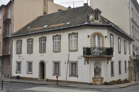 residential building: Budapest, Hungary - 26 December, 2015: White classicist residential building on the corner of the Donati and Hunyadi streets