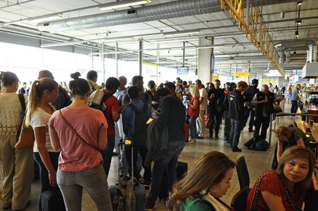 eindhoven: Eindhoven, Netherlands - May 12, 2016: Passangers waiting in the departure lounge of the Eindhoven Airport Editorial