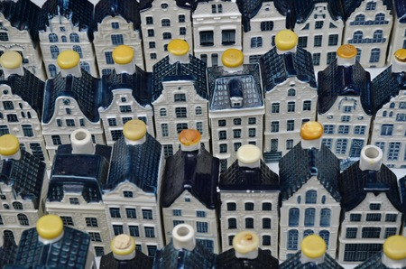 canal houses: Amsterdam, Netherlands - May 21, 2016: White KLM pottery canal houses at the weekend flee market on the Northern Market (Noordermarkt), in the Jordaan district.