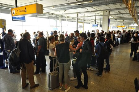 eindhoven: Eindhoven, Netherlands - May 12, 2016: Passangers waiting in the departure lounge of the Eindhoven Airport, near gate 4