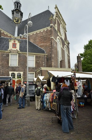 flee: Amsterdam, Netherlands - May 21, 2016: View of the weekend flee market at the Northern Market (Noordermarkt), in the side of the Northern Church (Noorderkerk), in the Jordaan district. Editorial