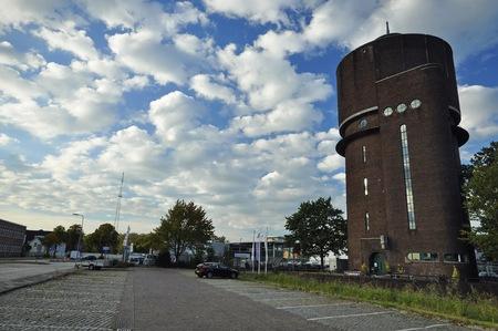 breda: Breda, Netherlands - October 16, 2016: The Amsterdam School style water tower building on the Speelhuislaan, under the cloudy sky