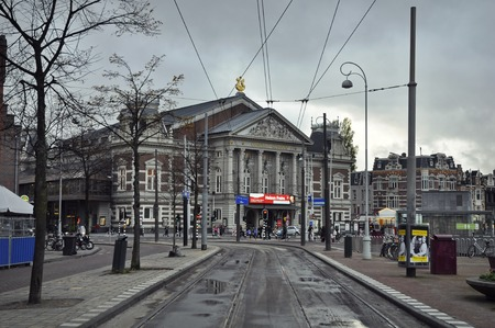 leonard: Amsterdam, Netherlands - November 16, 2016: View of the Concert Hall, designed by Adolf Leonard (Dolf) van Gendt from the Gabriel Metsustraat, with tram tracks ion the foreground.