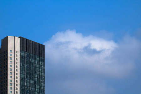 tall buildings: Blue sky, white clouds, tall buildings Editorial