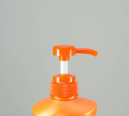 dollop: Orange Shampoo Bottle