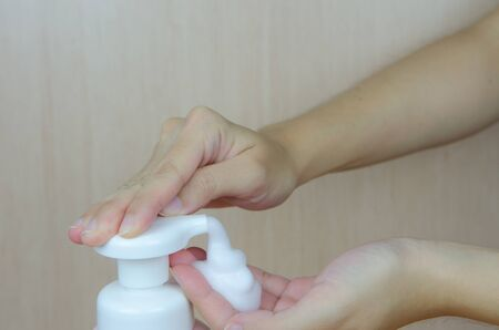 antibacterial soap: Putting whip foam soap on the hand
