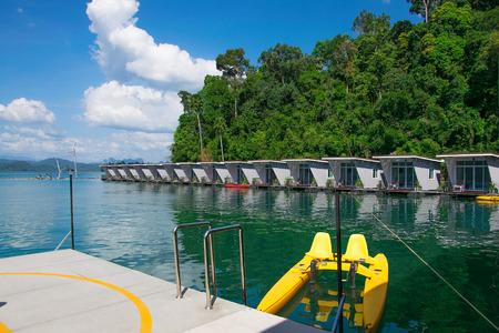 long tailed boat: Ferry port and floating house with watercycle in Ratchaprapha Dam, Khao Sok National Park, Surat Thani Province, Thailand