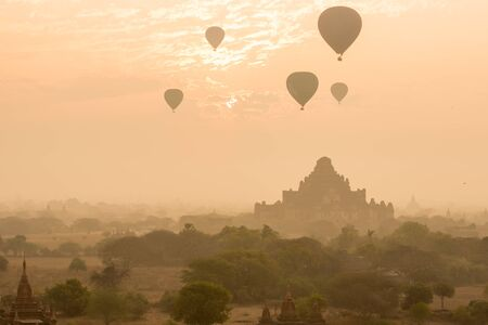 fascinate: Dhammayangyi temple The biggest Temple in Bagan with balloons and sunrise, Myanmar