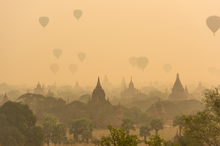 fascinate: Hot air balloon over plain of Bagan in misty morning before sunrise, Myanmar