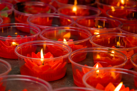 chinese holly: Red lotus shaped candles at chinese buddhist temple