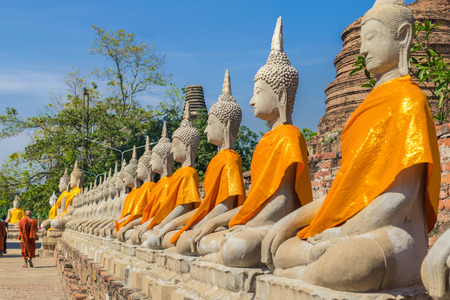 Buddha statues and monk at Wat Yai Chaimongkol Ayutthaya, Thailand