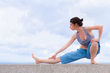 Young woman stretching outdoors Stock fotó - 17748635