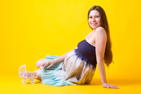 Pregnant woman with petite buggy Stock fotó - 29835242