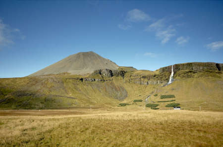 Icelandic farm with mountain and waterfall