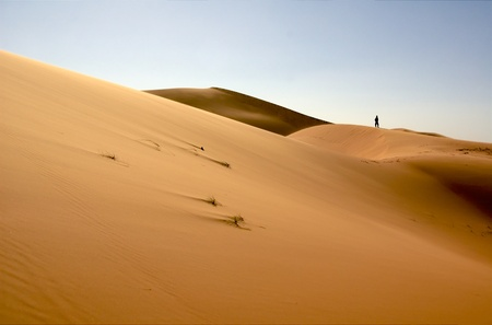 People at the dunes of the Moroccan Sahara Stock Photo