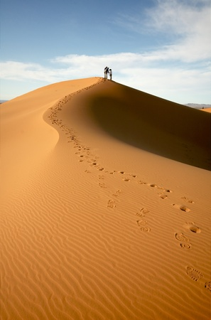 People at the dunes of the Moroccan Sahara photo