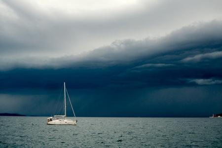 Sailboat returns to harbour at Zadar, Croatia photo