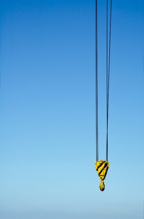 hook from crane against blue sky