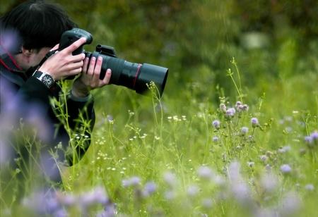 photographing: Photographer photographing a flower