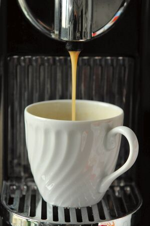 coffee cup at espresso machine Stock Photo
