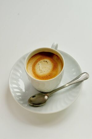 coffee on white cup with spoon