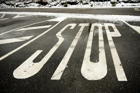Painted STOP indication at snowy road Stock Photo