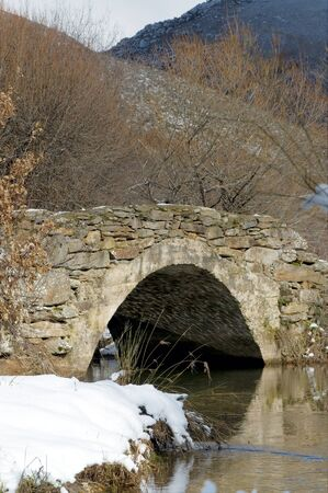 Old medieval bridge at the Spanish countryside