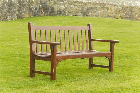 Enpty wooden bench by the garden photo