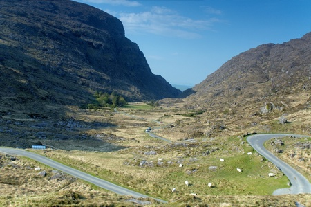 Road going down the valley heading to Gap of Dunloe, Ireland Stock Photo - 9817319