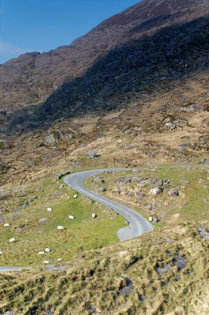 Road going down the valley heading to Gap of Dunloe, Ireland Stock Photo - 9817306