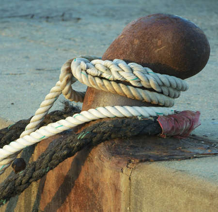 Set of ropes tight at a harbour Stock Photo