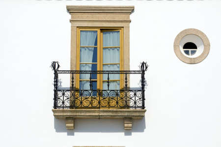 Window and balcony at a traditional house at Alentejo photo