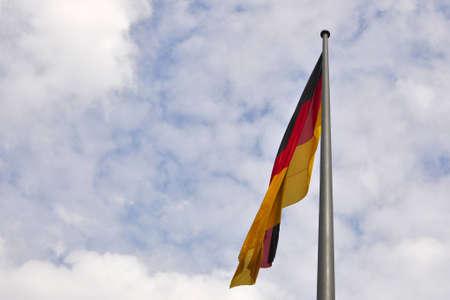 German flag on a pole against sloudy sky Stock Photo