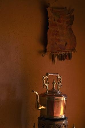 Traditional golden tea pot for mint tea a Morocco